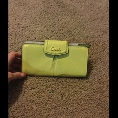 Coach wallet Coach Wallet Color is between a yellow and lime green Coach Bags Wallets