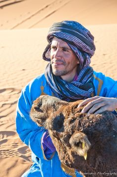 Friendship by Lazy Desperados  on 500px. Mubarak, tour guide in the Sahara with one of his dromedares.