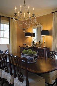 Beautiful classic dining room, textured wallpaper, black accents, a great chandelier makes the room