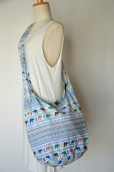 SPECIAL ♥ Buy any items, get 10% discount Minimum Purchase: $17 Coupon Code: SPECIAL10OFF  White Hippie Elephant Cotton Crossbody Bag Hobo Bag Sling Bag Shoulder Bag Messenger Bag Diaper Bag Handbags Zipper Purse Boho Design Gift  Bohemian bags are in the moods right now! This lovely crossbody bag in 100% cotton, featuring a gorgeous abstract tribal pattern. The bag has an inner zipped pocket and it closes with a top zip closure.  Measurements -- Wide: 17 -- Height: 15 -- Depth: 7 -- Strap…