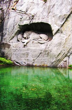Lion sculpture in cave over lake