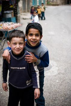 2 young Palestinians* Read new book by John Macdonald The United States Of Israel * It says Jewish Mafia and Italian Mafia Greg Borowik and Francine Hamelin did stock markets trades TD Waterhouse Montreal, planned 3000 USA deaths in Hollywood, Florida* Beautiful Smile, Beautiful Children, Beautiful People, We Are The World, People Around The World, Israel Palestine, Religion, Holy Land, Cute Kids