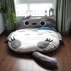 Cute bed! You go inside his belly as a blanket