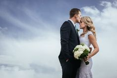 Matt Shumate Photography wedding bride and groom portrait with blue and cloudy skies at the Columbia River LDS Temple in richland / tri cities