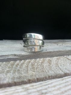 IDYLLIZ; Handmade silver ring with names on it.