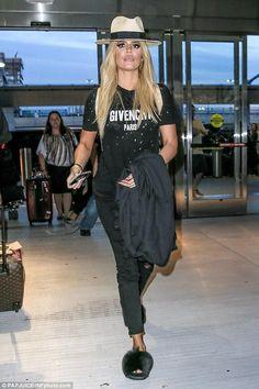 Khloe Kardashian wearing Chanel Spring 2014 Graffiti Backpack, Frame Le Color Rip Skinny Jeans in Noir, Givenchy Mink Fur & Rubber Slides and Givenchy Logo Print T-Shirt