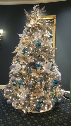 Beautiful gold and turquoise Christmas tree done at the Broadmoor Hotel in Colorado Springs, CO by Design Works - A Floral Studio in 2014