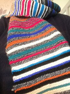 100% wool. Handknit in stocking stitch. Colours; stripes of of-white, vivid pink, mottled grey, teal green, orange, royal blue and turquoise blue  Long scarf: Tip to tip: approx 135 cm . Width: 33cm . Angela White, Long Scarf, Teal Green, Hand Knitting, Royal Blue, Knitted Hats, Stockings, Colours, Turquoise