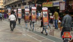 Walking Billboard is a new form of distinct, highly effective form of Outdoor Advertising. Walking Billboard person walks with the audiences to grab their attention. It is commonly used in European Countries and now it covers mainly the metro cities of India.