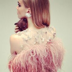 feathers, crystals, lace, and a puppy