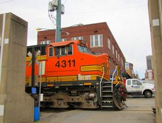 Train heads along the Mississippi in downtown Cape Girardeau by Eridony, via Flickr