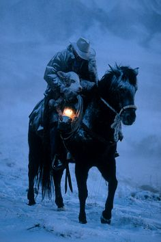 A Cowboy's Song. The cowboy's name is 'Limpy' and he went out into a blizzard with his faithful horse to rescue a calf that had 'strayed from it's maw.' A sad ending though. Cowboy Art, Cowboy And Cowgirl, Cowboy Horse, Cowboy Pics, Cowboy Song, Cowboy Quotes, Cowgirl Hats, Farm Animals, Cute Animals