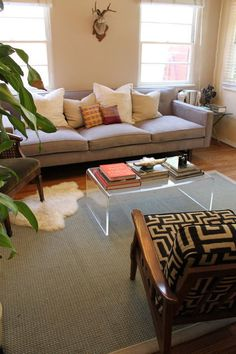 i like the use of the lucite coffee table. Like the combo of neutral sofa and a chair that pops in either color or pattern. Eclectic Living Room, Home Living Room, Interior Design Living Room, Room Interior, Interior Ideas, Deep Couch, Lucite Coffee Tables, Room Wanted, Corner Couch