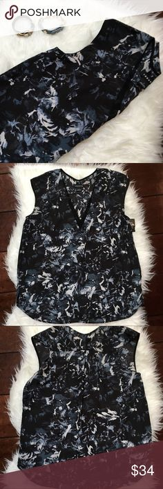 Trouve Small Blouse Trouve Sz Small Blouse  Sleeveless razor back with a center back pleat.  V-neck front with detail around the edging.  Black background with abstract pattern in blues and greys.  Scooped hem with small side slits that falls lower in back than front.    EUC 🚭 Trouve Tops Blouses