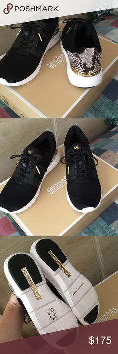Michael Kors sneakers size 7M Black Michael Kors sneakers with gold and snakeskin design on back. They are very comfortable and only worn once. Condition is almost as new !! MICHAEL Michael Kors Shoes Sneakers