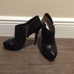 Michael Michael Kors booties Gently worn black Michael Michael Kors booties. In great condition. MICHAEL Michael Kors Shoes Ankle Boots & Booties
