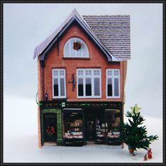 This christmas papercraft a christmas village decoration, created by Lesley Shepherd. This paper model is not only for a christmas village but also for a railway paper scene. It was designed as a d… Black Christmas Tree Decorations, Miniature Christmas Trees, Christmas Villages, Miniature Houses, Christmas Paper, Christmas Home, Christmas Glitter, Mini Houses, Christmas Wreaths