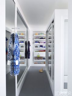 MONOCHROMATIC CLOSET In a Palm Beach penthouse designed by Timothy Haynes and Kevin Roberts, the crisp dressing room's cabinetry is crafted of Corian.