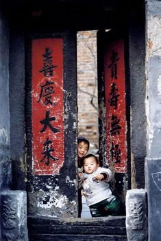 Peeking and taking a step out. Hutong doorway in Beijing, China.