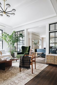 We love how these industrial windows add separation and a vintage touch to these living areas.+ industrial windows + black trim + transitional + living room | Design by Jean Stoffer Home Design Living Room, Home And Living, Living Room Decor, Living Spaces, Living Rooms, Modern Living, Interior Windows, Home Interior, Interior Decorating
