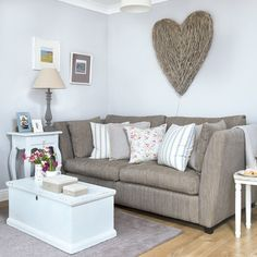 This small living room has been given an inviting and laid back country feel. Palest grey walls make an on-trend alternative to mundane magnolia to keep the room light and fresh.