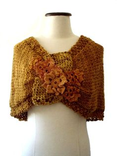 NIDO - hand knitting and crochet cover shoulders wrap poncho twisted mobius cowl - in gold. $68.00, via Etsy.