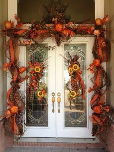 Fall doorway design by Flowers & Home of Bryant.  www.flowersandhome.com