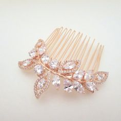 Exquisitely crafted Rose Gold bridal headpiece glitters beautifully with clear Swarovski Pure Brilliance Zircons. Personally designed and created by