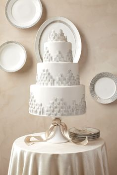 art deco inspired wedding cake in white and silver