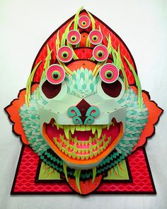 Michigan native AJ Fosik's is known for crafting 3D wood-based pieces—using both his hands and digital techniques—that call to mind American folk and tribal art, mostly thanks to his use of animals as a main subject and liberal additions of sharp claws, eyes, and teeth.