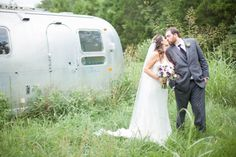 Bride and groom with Airstream at Cedarwood Weddings. Photo by Krista Lee, From Cassie + Chris' wedding at Cedarwood, Nashville TN #airstream #wedding