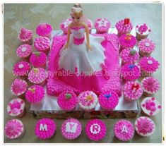 Barbie Cake and Cupcakes. this is what i was thinking.... do i have my helper again this year ms. laura??