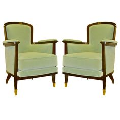 MAURICE JALLOT rare design pair of comfortable arm chairs  FRANCE  1930-1940  MAURICE JALLOT elegant and comfortable pair of arm chairs in rosewood newly upholstered in blue pale velvet with very chic frontleg gold bronze sabot