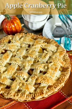Apple Cranberry Pie with flaky lattice crust and filling drenched in caramel-like sauce. Perfect for the weekends or holidays. | RotiNRice.com #applepie #cranberrypie #fruitpie #latticecrust
