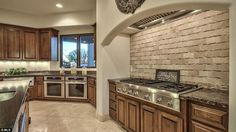 Alaskan flair in Arizona? A large family kitchen offers all the latest mod cons in a tradi...