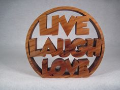 Another Live Laugh Love from Mister Scroller on Nevada County Makes site.  This one is done in a circular design and cut from Alder wood.  It sells for $27.00