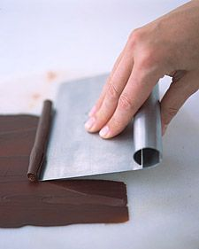 Chocolate Curls- Coils of chocolate make an impressive dessert garnish, and they are easy to make. Melt chopped sweet chocolate, pour it onto a flat surface, spread it to a thin, even thickness, and let cool. Scrape it off with a bench scraper, a wide metal spatula for cleaning dough from work surfaces. Or use a vegetable peeler to slice strips from a block of chocolate.