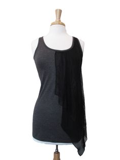 Dark grey tank with a black lace overlay in front provides a dramatic look. The back is made of only lace in some areas which allows for a hint of sexy.