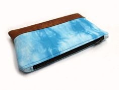 Sky blue hand dyed clutch with brown faux leather base. #clutch #clutchbag #blue #shibori #bag #purse #handdyed #dyed