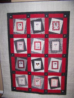 Crazy nurse quilt in red white and black by Quiltsandcollections, $360.00.  Won 3rd place in 2007 KY State Fair. Nurses have Swarovski Crystal earrings and cornerstones have medical related buttons stitched on Loralie Design fabric.