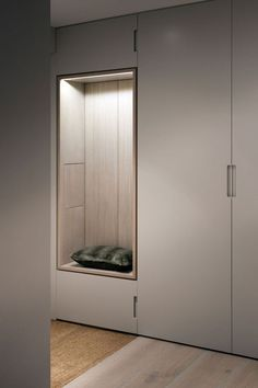 Simple plywood colored closet with wood or stone in-lay for the seating area & mirror