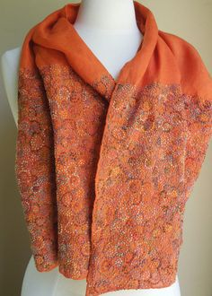 Lampions scarf  by Sophie Digard ~ scroll pattern embroidered on 11 inches of each hem on burnt orange linen, 50 x 18 inches