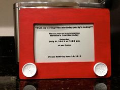 "toy story invitation : Wooden ""Etch-A-Sketch""  basic wooden craft frame painted red, wooden knobs painted white and glued to frame.  Add a snack size ziploc filled with sand to the back of the frame, cover with heavy cardstock. Shake it and it sounds just like an etch a sketch!"