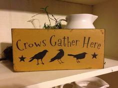 Crows Gather Here...perfect sign for a crow collector! I painted this sign a warm mustard with black lettering. I aged the sign to look