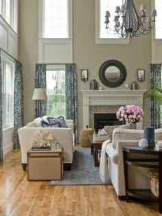 "Two-story family room. Tall ceilings: pick a ""height line"" and keep everything the same and under it. Love the chandelier and how it fills the space brought lower."