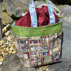 Project bag £17  I have used quality cotton to make this bag , i have added a light interface to the fabric for structure , the top opens wide enough so that it can be folded back so that you can keep your yarn inside bag while knitting. I use mine when knitting socks two at a time magic loop, and find that two yarn balls fit in comfortably . This is a one of a kind there is not another one made exactly the same , Idea for socks. Hats ,shawls, childrens jumpers . Width 11inches at top or…