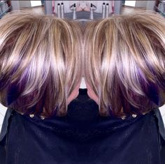 Blonde hair with brown highlights and purple peek a boos.