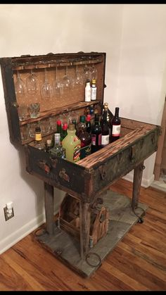 One of a kind steamer trunk made into a bar cart with some Scrap wood and old horse yokes as legs