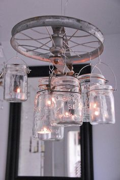 DIY chandelier from mason jars and a pulley (or kids' bike wheel!)