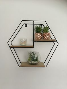 I love injecting our own style into the house and love our geometric shelves.